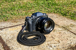 Fujifilm X-T1, equipped with our black El Capitan strap, made from a black sailing rope and black leather with a black and red stitching.