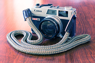 canonet ql with handmade camera strap