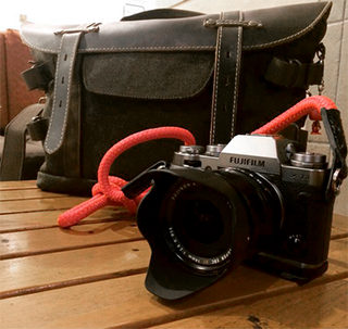Fujifilm X-T1 equipped with handsewn camera strap from sailor strap