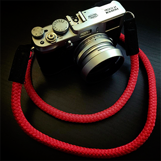 Fujifilm X100S equipped with handmade camera strap from sailor strap