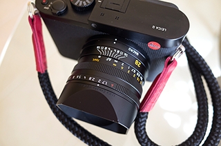 leica q with handmade krampus lieutennt camera strap from sailor strap