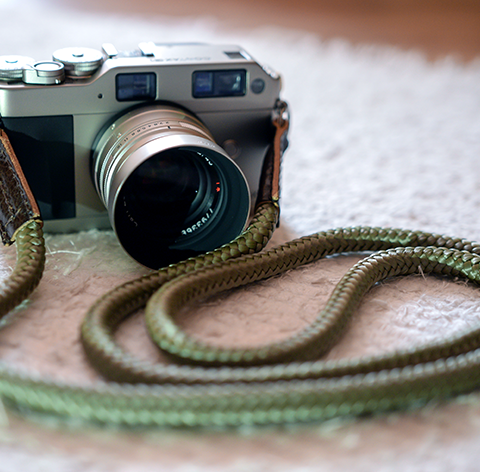 contax g1 rangefinder camera equipped with the lieutenant olive green and brown lleather camera strap, handmade,