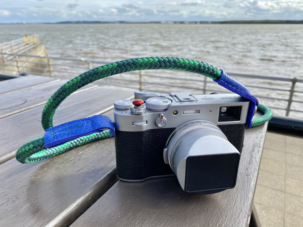 x100v with a handmade rope camera strap